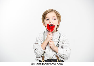 Boy with heart shaped lollipop