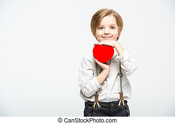 Boy with heart sign