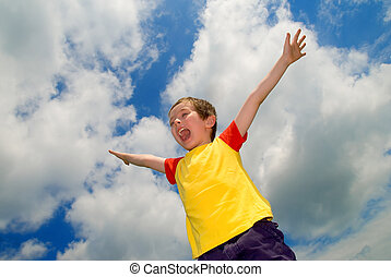 Boy with his arms wide open
