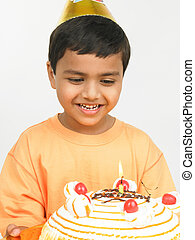 boy with his birthday cake