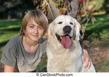 Boy with his dog in the park
