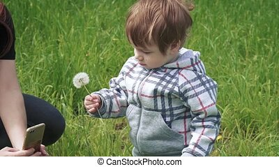 Boy with his mother on the lawn