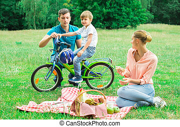 Boy With His Parents In The Park