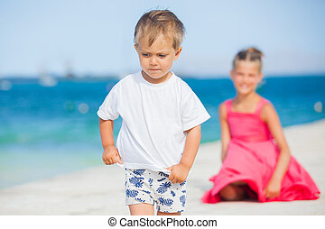 Boy with his sister walking on jetty