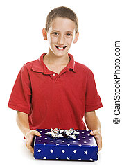 Boy with Holiday Gift - Cute little boy holding a holiday...