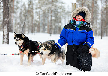 Boy with husky dog