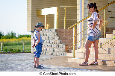 Boy with Ice Cream Being Scolded by Angry Mother