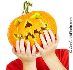 boy with jack-o-lantern. halloween.