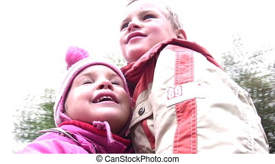 boy with little girl on carousel