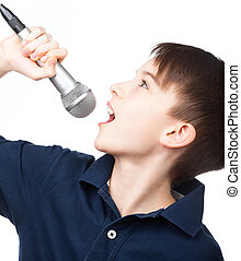 Boy with microphone singing - Cute kid singing holding...