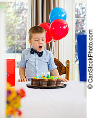 Boy With Mouth Open Looking At Cake