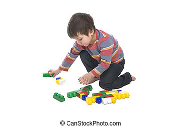 Boy with multicolored bricks