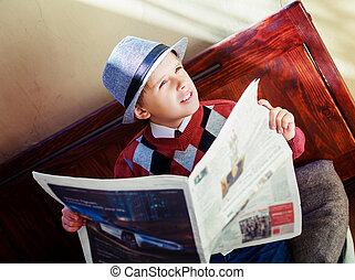 boy with newspaper - happy stylish boy with a newspaper on...