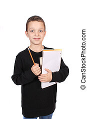 Boy with notebook and pencil
