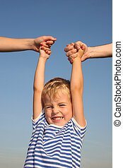 boy with parents hands