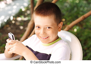 Boy with phone outdoor