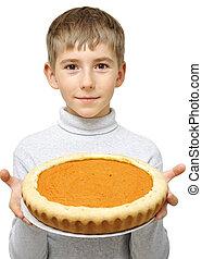 Boy with pumpkin pie