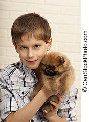 Boy with puppy.