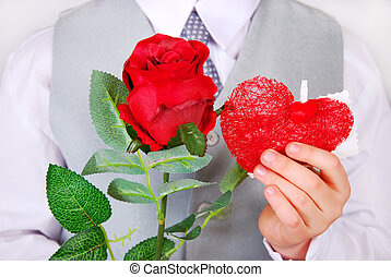 boy with red rose and heart - little boy giving red rose and...