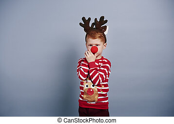 Boy with reindeer antlers and red nose