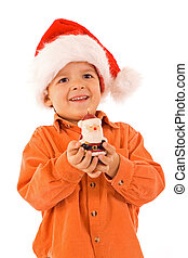 Boy with santa hat and candle - isolated