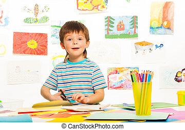Boy with scissors