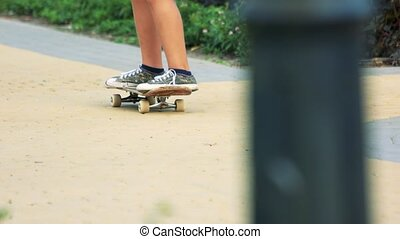 Boy with skate board. Close up. Skateboarder riding...