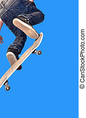 skate board going airborne - boy with skate board going...