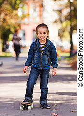 Boy with skateboard in park