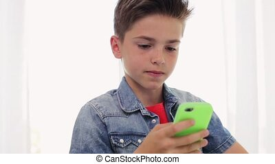 boy with smartphone at home - children, technology and...
