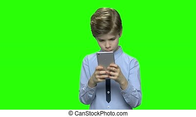 Boy with smartphone texting message.