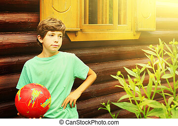 boy with soccer ball close up country