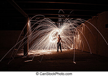 boy with steel wool in abandoned factory
