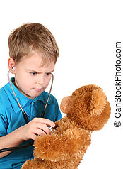 boy with stethoscope and toy