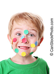 Boy with stickers on his face