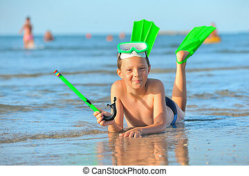 boy with  swimming goggles, snorkel swimming and flippers