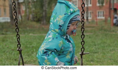 Boy with swing on the park