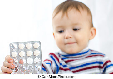 Boy with tablets in hands