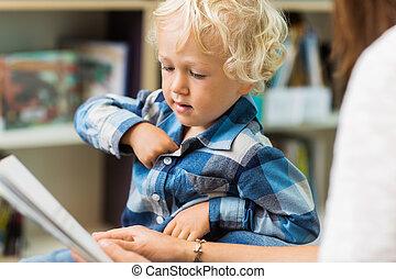 Boy With Teacher Reading Book