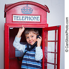 Boy with telephone - Cute little boy in the red telephone...