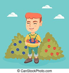 Boy with the basket of strawberry and blueberry. - Caucasian...