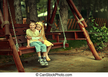 boy with the girl on a swing