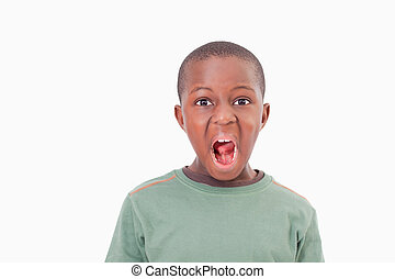 Boy with the mouth open against a white background