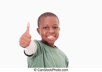Boy with the thumb up against a white background