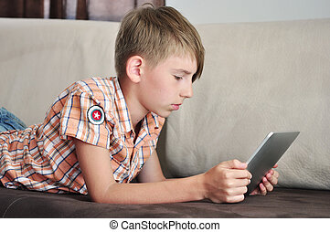boy with touchscreen tablet