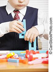 Boy with toy blocks closeup