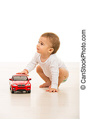 Boy with toy car looking away - Toddler boy with toy car...