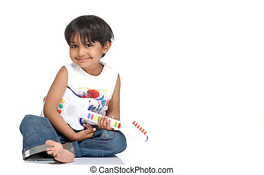 boy with toy guitar