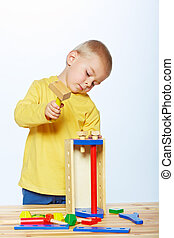 boy with toy hammer