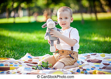 Boy with toy in the park